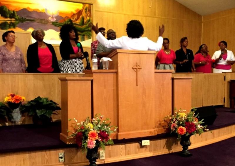 Rev. Dansiea Morris directs the choir ensemble